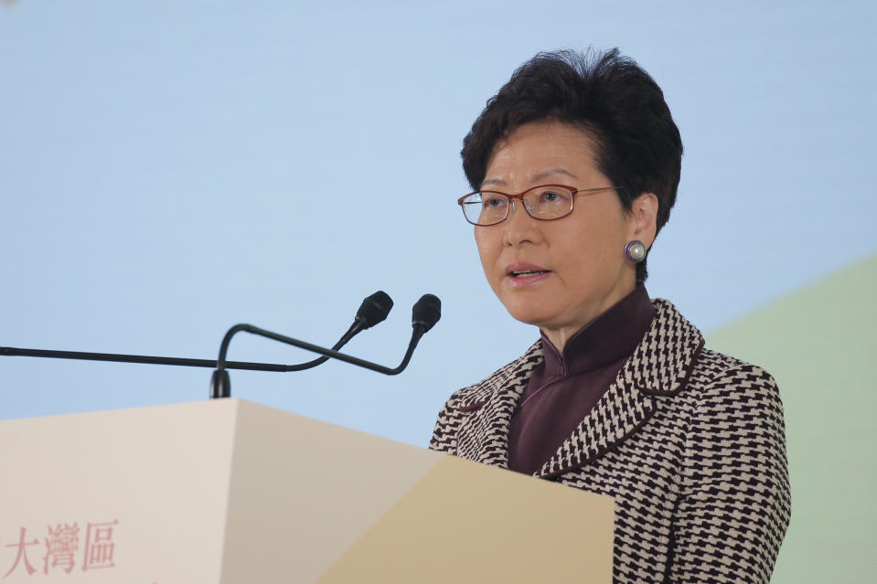 "Hong Kong's Chief Executive Carrie Lam speaks during a symposium on the ""Outline Development Plan for the Guangdong-Hong Kong-Macao, Greater Bay Area"" in Hong Kong, Thursday, Feb. 21, 2019. The Greater Bay Area linking up Hong Kong, Macao with 9 other cities is set to shift the Southern China from traditional manufacturing into a world-class hi-tech economic powerhouse to rival the Silicon Valley and Tokyo's Bay Area. (AP Photo/Kin Cheung)"