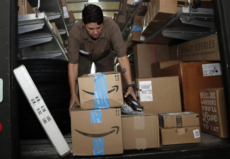 "FILE - In this July 17, 2018, file photo UPS employee Liz Perez unloads packages for delivery in Miami, Tuesday, July 17, 2018. Amazon's ""Prime Day"" is back. The made-up holiday, first launched in 2015, has become one of Amazon's busiest shopping days, offering discounts on gadgets, TVs and other goods. (AP Photo/Lynne Sladky)"