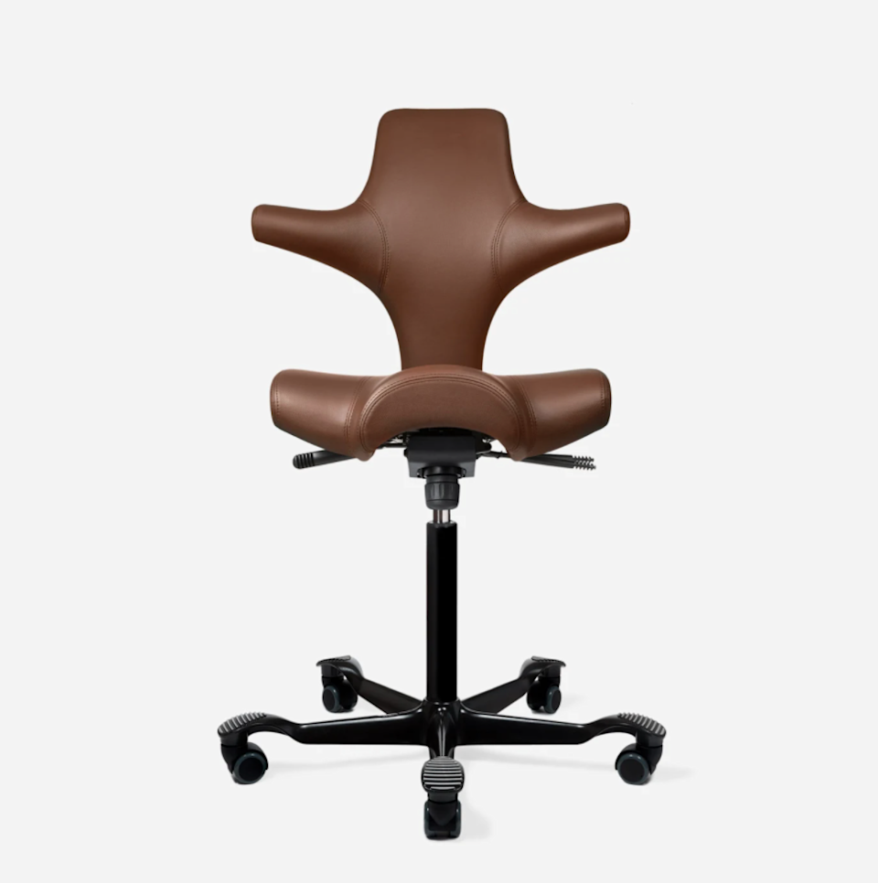 """<h2>Best Unique Ergonomic Office Chair<br></h2><br><h3>Fully Capisco Chair by HAG</h3><br>As you probably already know, ergonomic office chairs tend to take on a similar look — black mesh, curvy backs, armrests, and so on. However, Fully sells unique designs like this Capisco chair that bring you comfort in all kinds of new eye-catching styles. And it's not just about eye-catching looks. The puzzle piece shape is designed for backwards or sideways seating, and the saddle seat helps keep your hips open. Bonus: it comes in a whopping 12 colorways.<br><br><em>Shop <a href=""""https://www.fully.com/chairs/hag-capisco-chair.html"""" rel=""""nofollow noopener"""" target=""""_blank"""" data-ylk=""""slk:Fully"""" class=""""link rapid-noclick-resp""""><strong>Fully</strong></a></em><br><br><strong>Fully</strong> Capisco Chair by HÅG, $, available at <a href=""""https://go.skimresources.com/?id=30283X879131&url=https%3A%2F%2Fwww.fully.com%2Fchairs%2Fhag-capisco-chair.html"""" rel=""""nofollow noopener"""" target=""""_blank"""" data-ylk=""""slk:Fully"""" class=""""link rapid-noclick-resp"""">Fully</a>"""