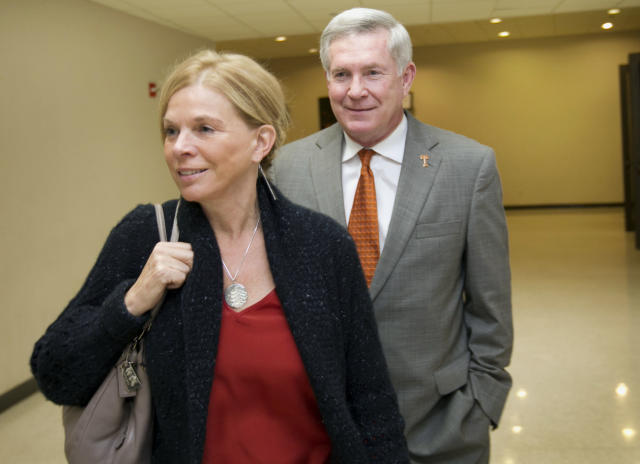 Texas head coach Mack Brown arrives with his wife, Sally, at the University of Texas Longhorns Honors banquet at the Frank Erwin Center in Austin on Friday Dec.13, 2013. (AP Photo/Austin American-Statesman, Jay Janner)