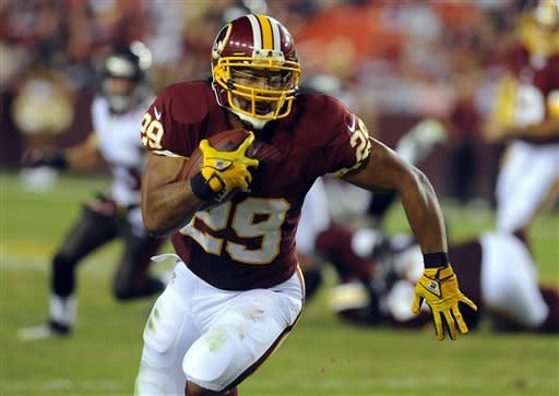 Washington Redskins running back Roy Helu runs with the ball during the first half of an NFL preseason football game against the Tampa Bay Buccaneers, Wednesday, Aug. 29, 2012, in Landover, Md. (AP Photo/Richard Lipski)
