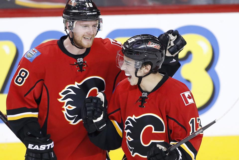 Calgary Flames' Johnny Gaudreau, right, celebrates with Matt Stajan after Gaudreau's goal against the Los Angeles Kings during the first period of an NHL hockey game Thursday, April 9, 2015, in Calgary, Alberta. (AP Photo/The Canadian Press, Larry MacDougal)