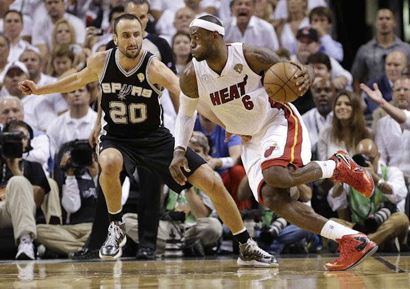 Miami Heat small forward LeBron James (6) moves the ball against San Antonio Spurs shooting guard Manu Ginobili (20) during the second half of Game 6 of the NBA Finals basketball game, Tuesday, June 18, 2013 in Miami. (AP Photo/Lynne Sladky)