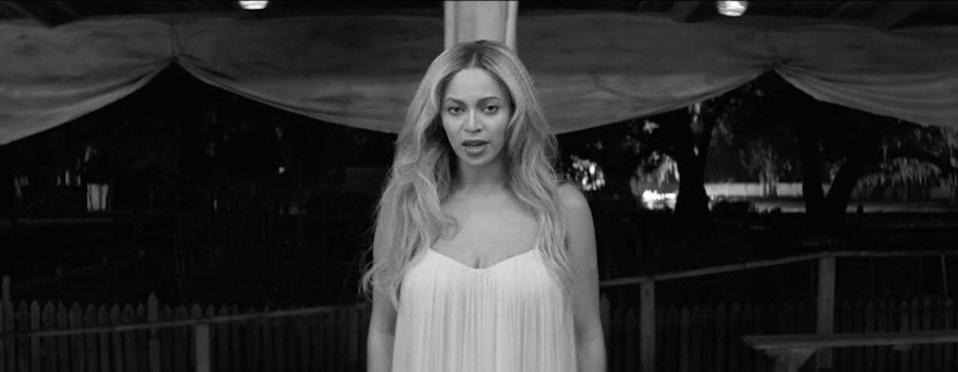 <p>Beyoncé, her hair down and tousled, sings about freedom in black and white.</p>