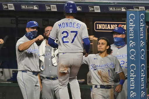 Kansas City Royals' Adalberto Mondesi is congratulated after scoring during the eighth inning of the team's baseball game against the Cleveland Indians, Tuesday, Sept. 8, 2020, in Cleveland. (AP Photo/Tony Dejak)