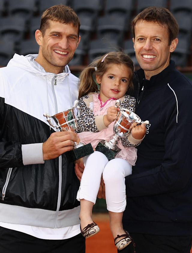 PARIS, FRANCE - JUNE 09: Max Mirnyi (L) of Belarus and Daniel Nestor of Canada pose with Nestor's daughter Tiana after defeating Bob and Mike Bryan of the USA in the men's doubles final during day 14 of the French Open at Roland Garros on June 9, 2012 in Paris, France. (Photo by Matthew Stockman/Getty Images)