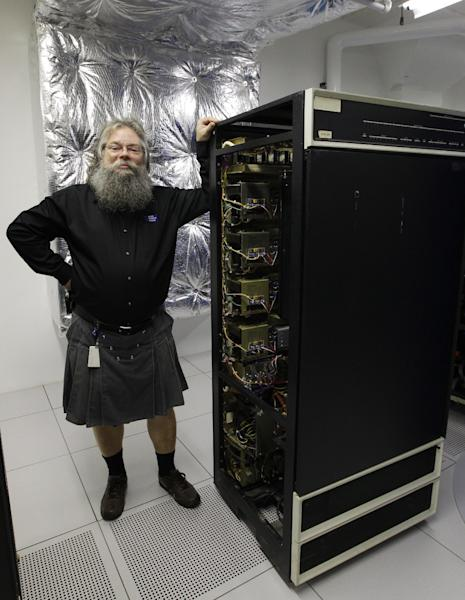 In this photo taken Oct. 30, 2012, Ian King, senior vintage systems engineer at the Living Computer Museum in Seattle, stands by a memory module of a DEC PDP-10 computer from the early 1970s that holds 16 kilobytes of computer memory. The working machine is part of the collection of running computers at Paul Allen's newly opened Living Computer Museum. (AP Photo/Ted S. Warren)