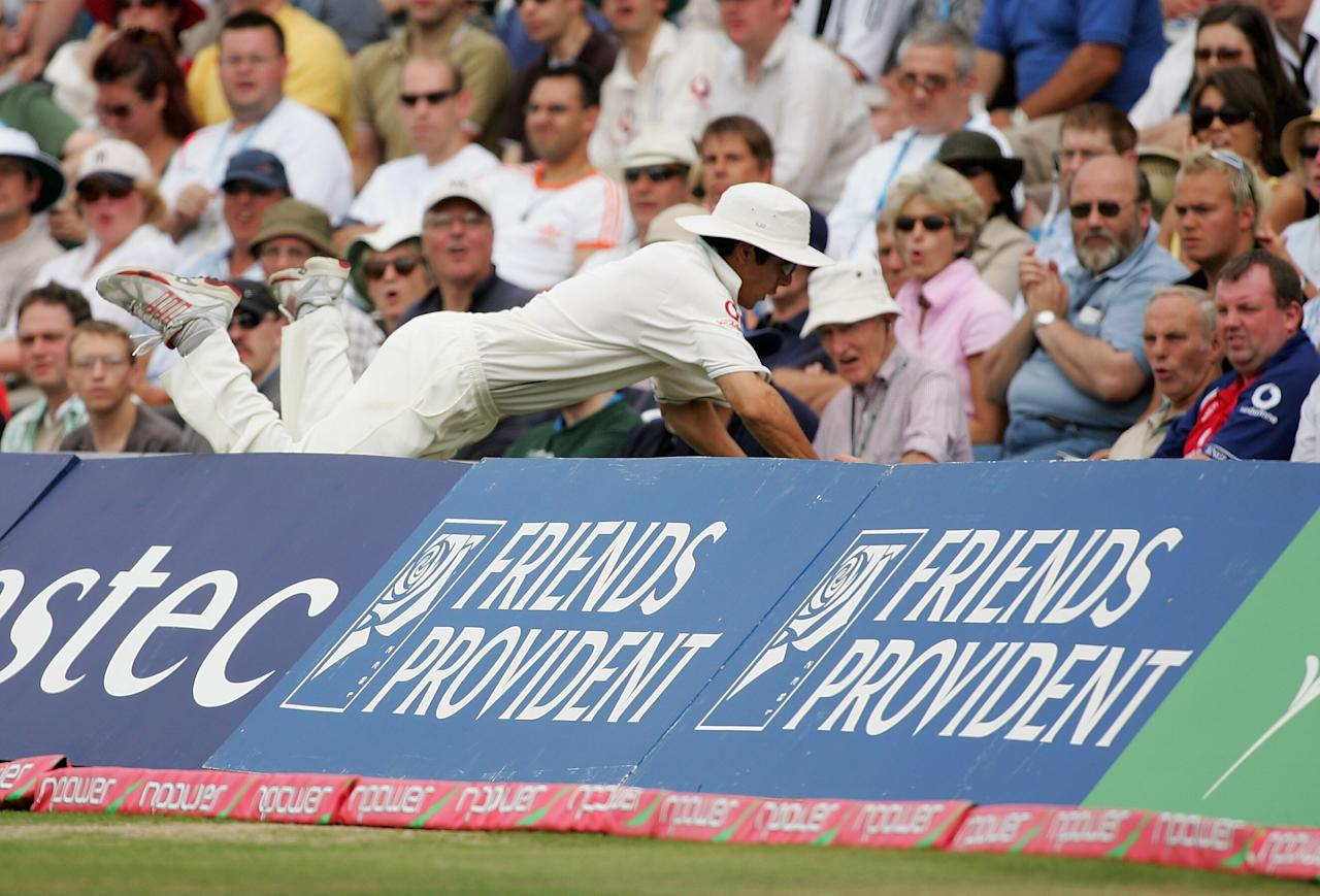 LEEDS, UNITED KINGDOM - AUGUST 06:  Alastair Cook of England falls into the advertising boards trying to save four runs during day three of the third npower test match between England and Pakistan at Headingley on August 6, 2006 in Leeds, England.  (Photo by Mike Hewitt/Getty Images)
