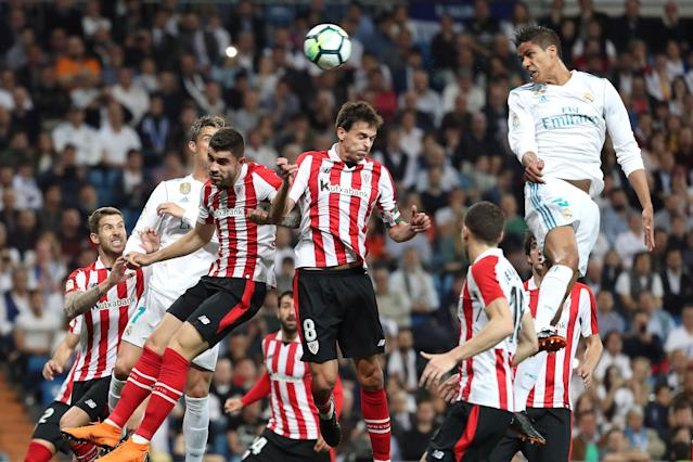 Soccer Football - La Liga Santander - Real Madrid vs Athletic Bilbao - Santiago Bernabeu, Madrid, Spain - April 18, 2018 Real Madrid's Raphael Varane in action with Athletic Bilbao's Ander Iturraspe REUTERS/Susana Vera