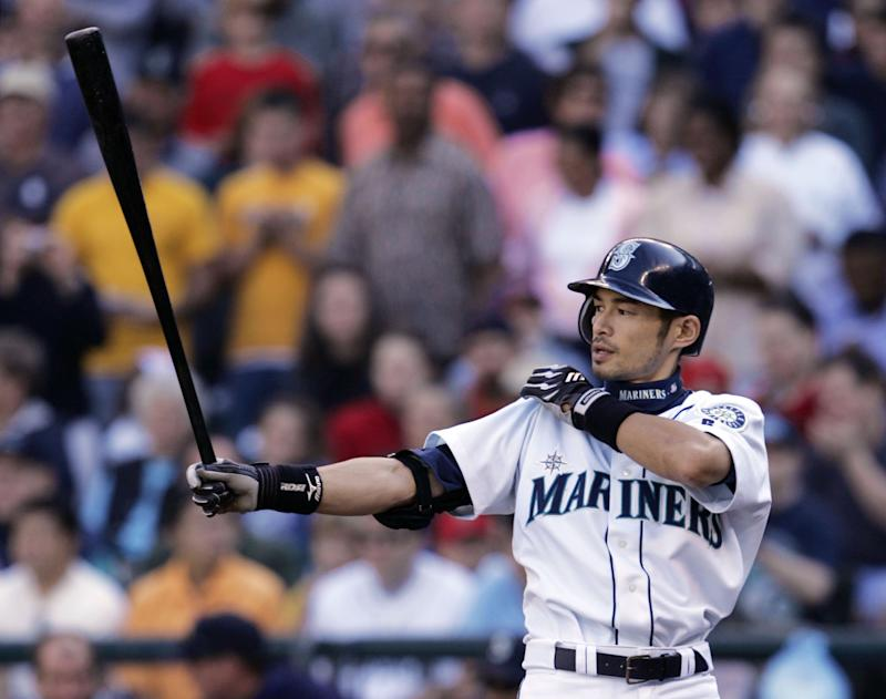 Seattle Mariners' Ichiro Suzuki gives a final tug to his sleeve during his turn at bat in the eighth inning Sunday, Oct. 3, 2004, in Seattle. Suzuki pushed his major league record for hits in a season to 262 with singles in the third inning off Park and in the eighth off Brian Shouse. Suzuki broke George Sisler's 1920 mark of 257 hits on Friday. (AP Photo/Elaine Thompson)