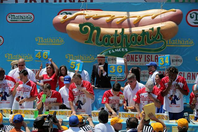 <p>People compete in Nathan's Famous Fourth of July International Hot Dog-Eating Contest at Coney Island in Brooklyn, New York City, U.S., July 4, 2017. (Andrew Kelly/Reuters) </p>