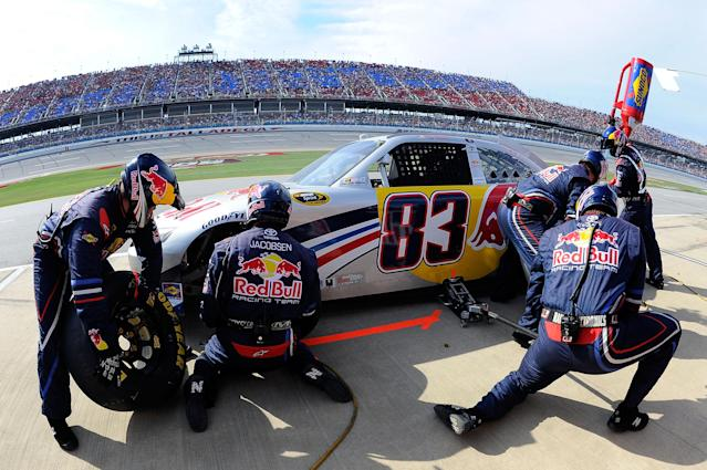 TALLADEGA, AL - OCTOBER 23: Brian Vickers, driver of the #83 Red Bull Toyota, makes a pit stop during the NASCAR Sprint Cup Series Good Sam Club 500 at Talladega Superspeedway on October 23, 2011 in Talladega, Alabama. (Photo by Jason Smith/Getty Images)