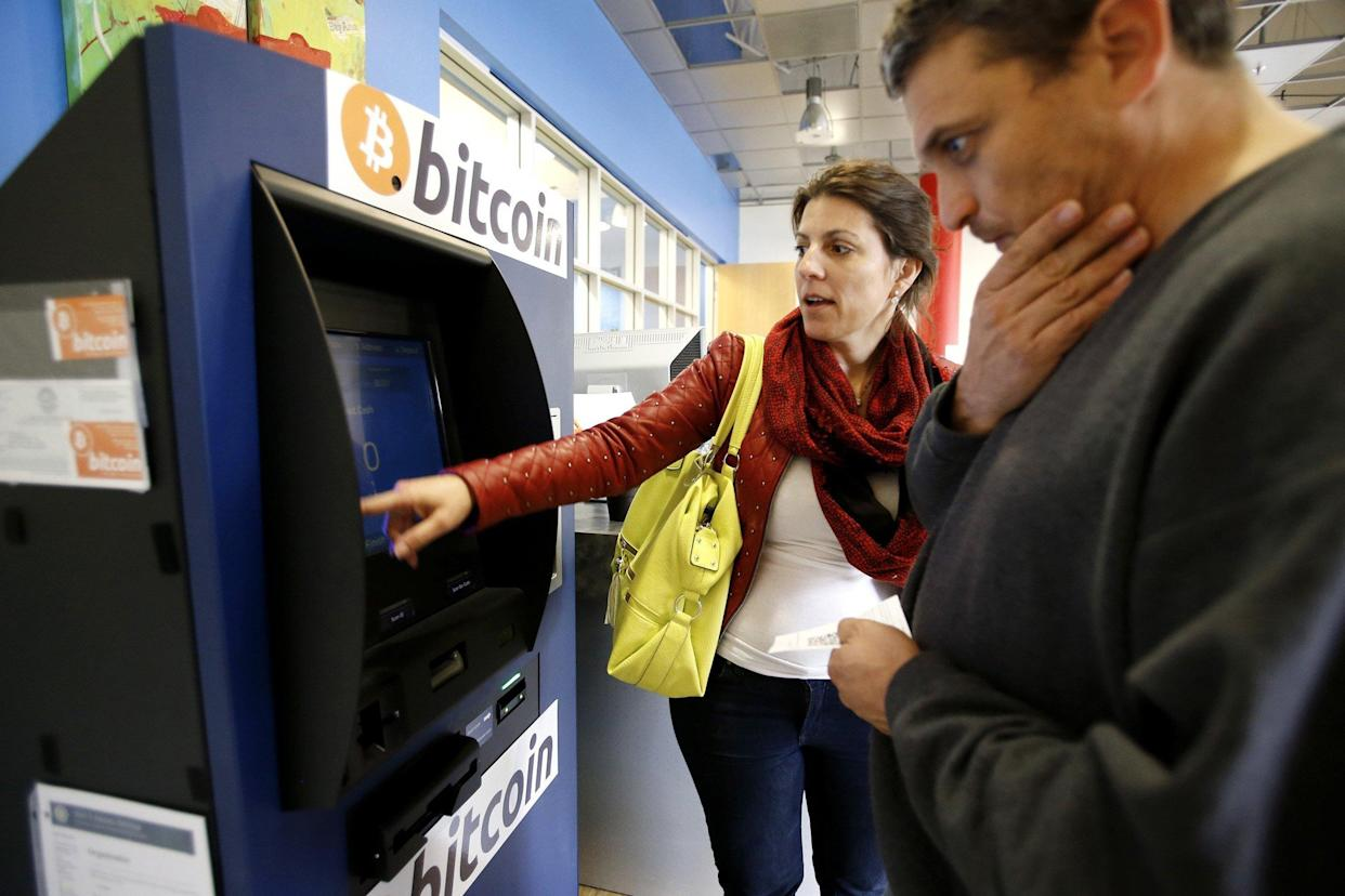 Hami Oerner and Itzik Lerner, right, learn how to use a new bitcoin ATM machine at Hacker Dojo in Mountain View, Calif., April 1, 2014. Robocoin is California's first permanent 24/7 bitcoin ATM machine. (Photo by Gary Reyes/Bay Area News Group/MCT/Sipa USA)