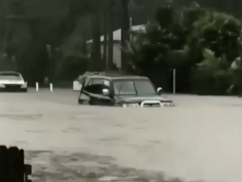 A car in flood waters on the NSW South Coast.
