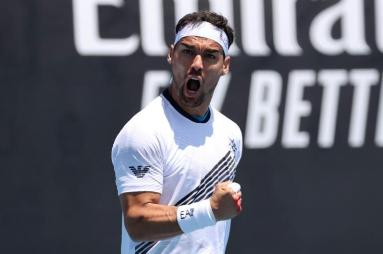 Italy's Fabio Fognini came back from two sets down to beat Reilly Opelka