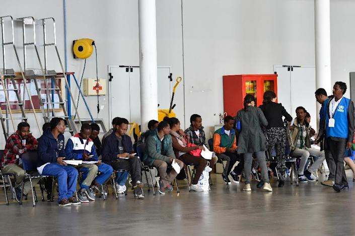 A group of Eritrean refugees prepare to board a plane to travel to Sweden as part of a new EU programme to relocate refugees, on October 9, 2015 at Rome's Ciampino airport (AFP Photo/Andreas Solaro)