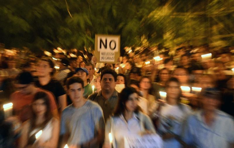Thousands of demonstrators rally in front of the Congress in Asuncion on April 3, 2017 to protest against a bid to lift a ban on President Horacio Cartes that would allow him to be reelected