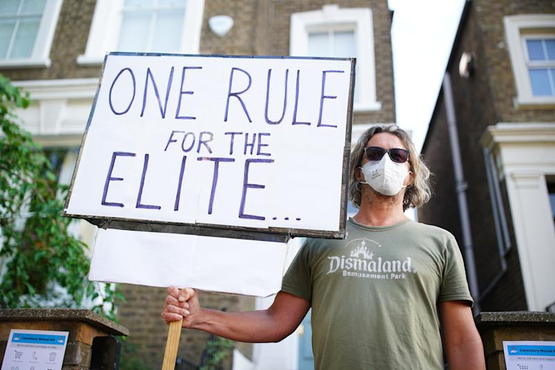 A protester outside the north London home of Prime Minister Boris Johnson's senior aide Dominic Cummings after he gave a press conference over allegations he breached coronavirus lockdown restrictions.