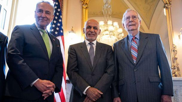 PHOTO: Senate Majority Leader Chuck Schumer, President of Afghanistan Ashraf Ghani and Senate Minority Leader Mitch McConnell pose for pictures before a meeting at the U.S. Capitol on June 24, 2021, in Washington. (Drew Angerer/Getty Images)