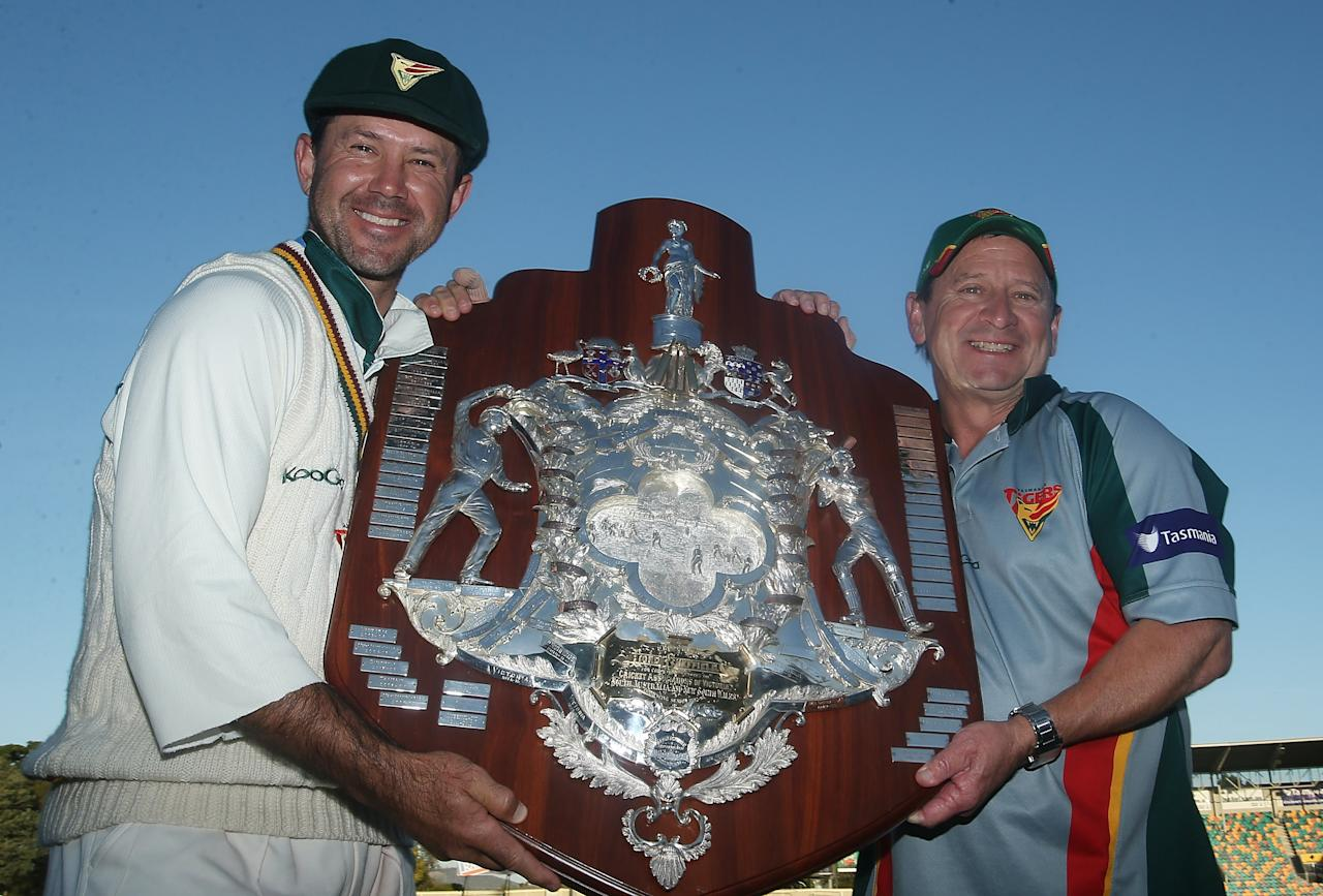 HOBART, AUSTRALIA - MARCH 26:  Ricky Ponting of the Tigers and coach Tim Coyle pose with the Sheffield Shield trophy after victory in the Sheffield Shield final between the Tasmania Tigers and the Queensland Bulls at Blundstone Arena on March 26, 2013 in Hobart, Australia.  (Photo by Mark Metcalfe/Getty Images)