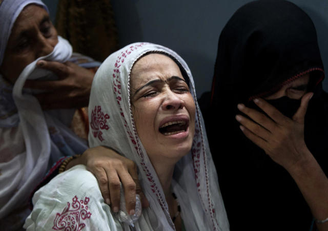 <p>A Pakistani mother, center, mourns over the death of her son who was killed in a bomb explosion, in Karachi, Pakistan, Aug. 7, 2013. (AP Photo/Shakil Adil) </p>