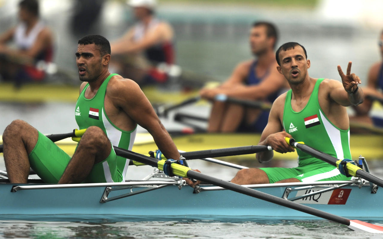Iraq's Hussein Jebur, right, and Haidar Nozad react after racing in the Men's double sculls repechage at the Beijing 2008 Olympics rowing in Beijing Tuesday Aug.11, 2008. (Kevork Djansezian)