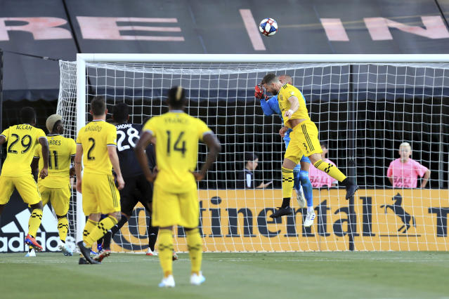 Montreal Impact's Evan Bush, back, is unable to make save as Columbus Crew's Josh Williams, front, scores a goal during the first half of an MLS soccer match, Saturday, July 20, 2019, in Columbus, Ohio. (AP Photo/Aaron Doster)