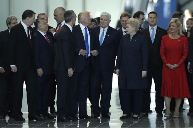 <p>Montenegro Prime Minister Dusko Markovic, center right, smiles after appearing to be pushed by Donald Trump, center left, during a NATO summit of heads of state and government in Brussels on Thursday, May 25, 2017. US President Donald Trump inaugurated the new headquarters during a ceremony on Thursday with other heads of state and government. (AP Photo/Matt Dunham) </p>
