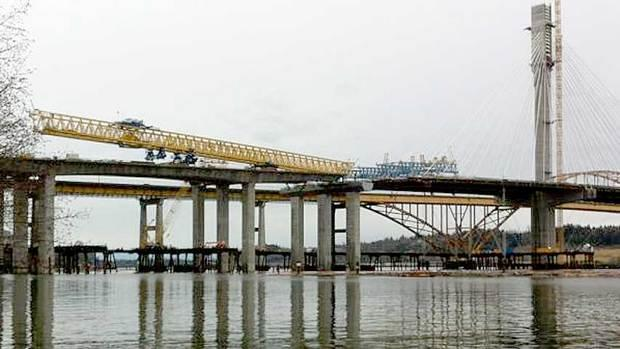 A 720-tonne gantry crane tipped off its rails on Friday, dropping a section of the new Port Mann bridge into the Fraser River, just east of Vancouver.