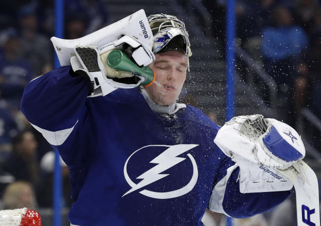 Tampa Bay Lightning goaltender Andrei Vasilevskiy (88) sprays water on his face during the third period of an NHL hockey game against the Toronto Maple Leafs Thursday, Dec. 13, 2018, in Tampa, Fla. (AP Photo/Chris O'Meara)