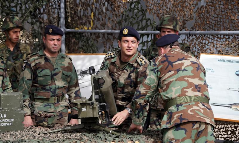 Lebanese soldiers inspect an anti-tank missile launcher during a hand-over ceremony of a shipment of French weapons to the Lebanese Army at Beirut International Airport on April 20, 2015