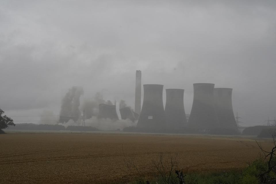 The cooling towers being demolished (Peter Byrne/PA) (PA Wire)