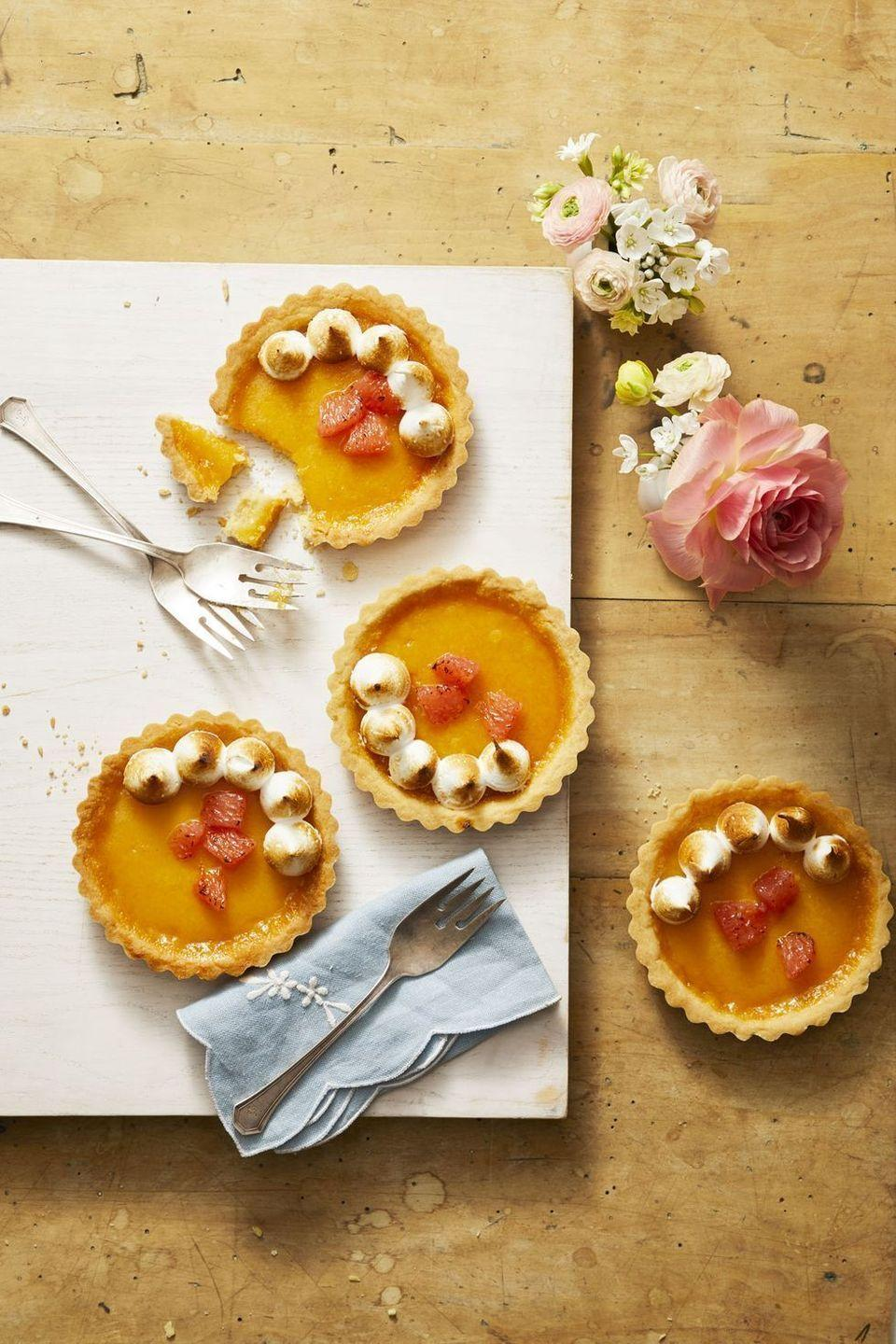"""<p>Top these citrus-infused tarts with homemade sugary-sweet meringue.</p><p><em><a href=""""https://www.goodhousekeeping.com/food-recipes/dessert/a26767705/ruby-red-grapefruit-tartlets-recipe/"""" rel=""""nofollow noopener"""" target=""""_blank"""" data-ylk=""""slk:Get the recipe for Ruby Red Grapefruit Tartlets »"""" class=""""link rapid-noclick-resp"""">Get the recipe for Ruby Red Grapefruit Tartlets »</a></em></p>"""