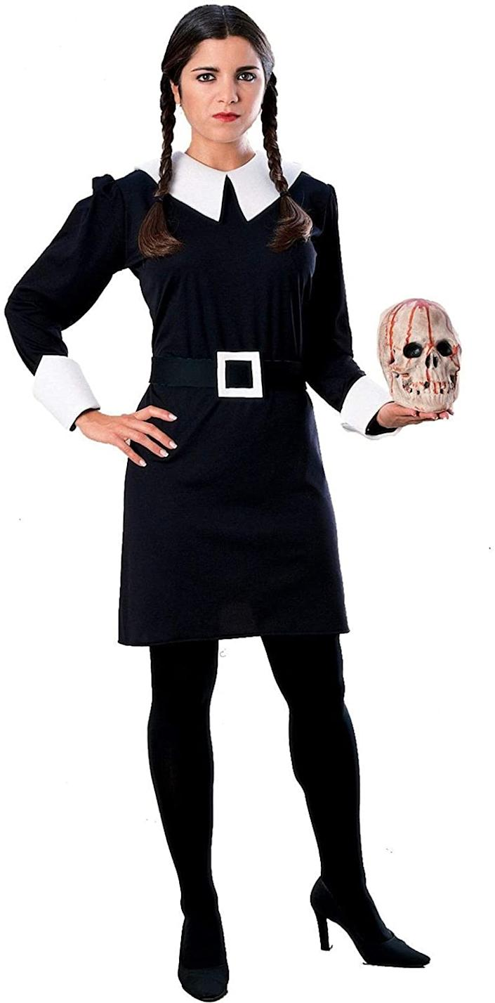 Woman dressed as Wednesday Addams in black collared dress and braids.