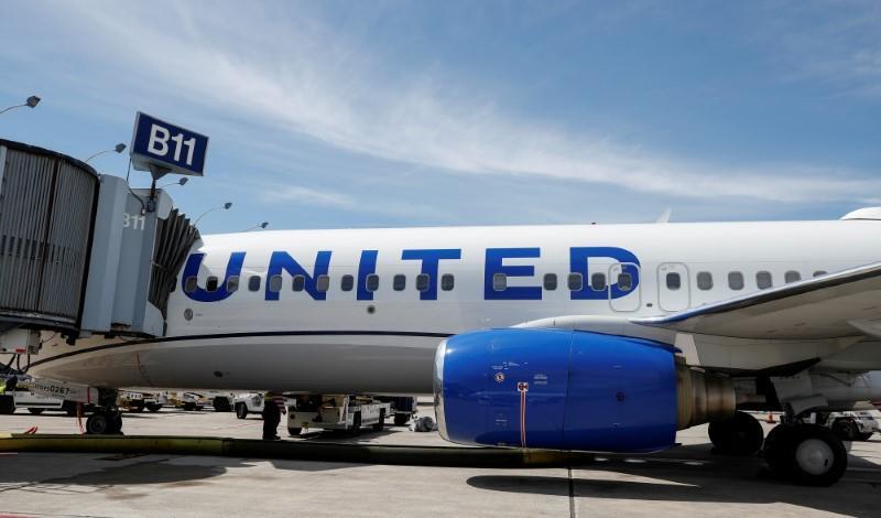 FILE PHOTO: United Airlines first new livery Boeing 737-800 sits at a gate O'Hare International Airport in Chicago