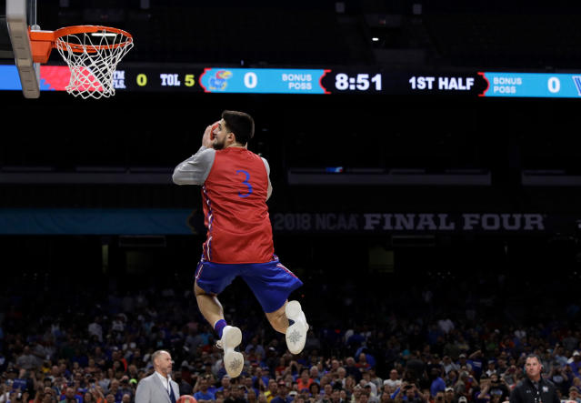 Kansas's Sam Cunliffe (3) goes up for a shot during a practice session for the Final Four NCAA college basketball tournament, Friday, March 30, 2018, in San Antonio. (AP Photo/David J. Phillip)