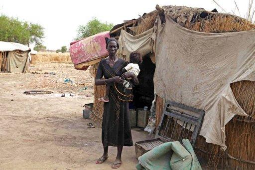 Nyrop Nyol stands outside her home in Wunchuei, near the contested region of Abyei in March