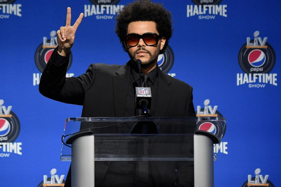 <p>The Weeknd takes the podium during the Pepsi Super Bowl LV halftime show press conference at the Tampa Convention Center on Thursday in Tampa, Florida.</p>