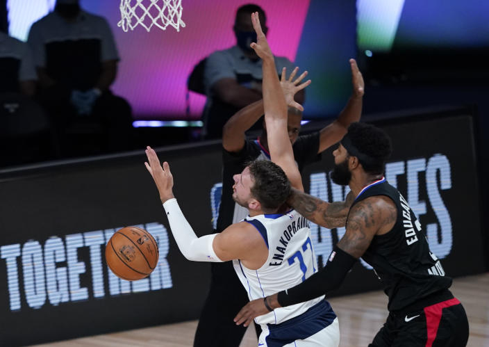 Marcus Morris got ejected for this foul on Luka Doncic. (AP Photo/Ashley Landis)