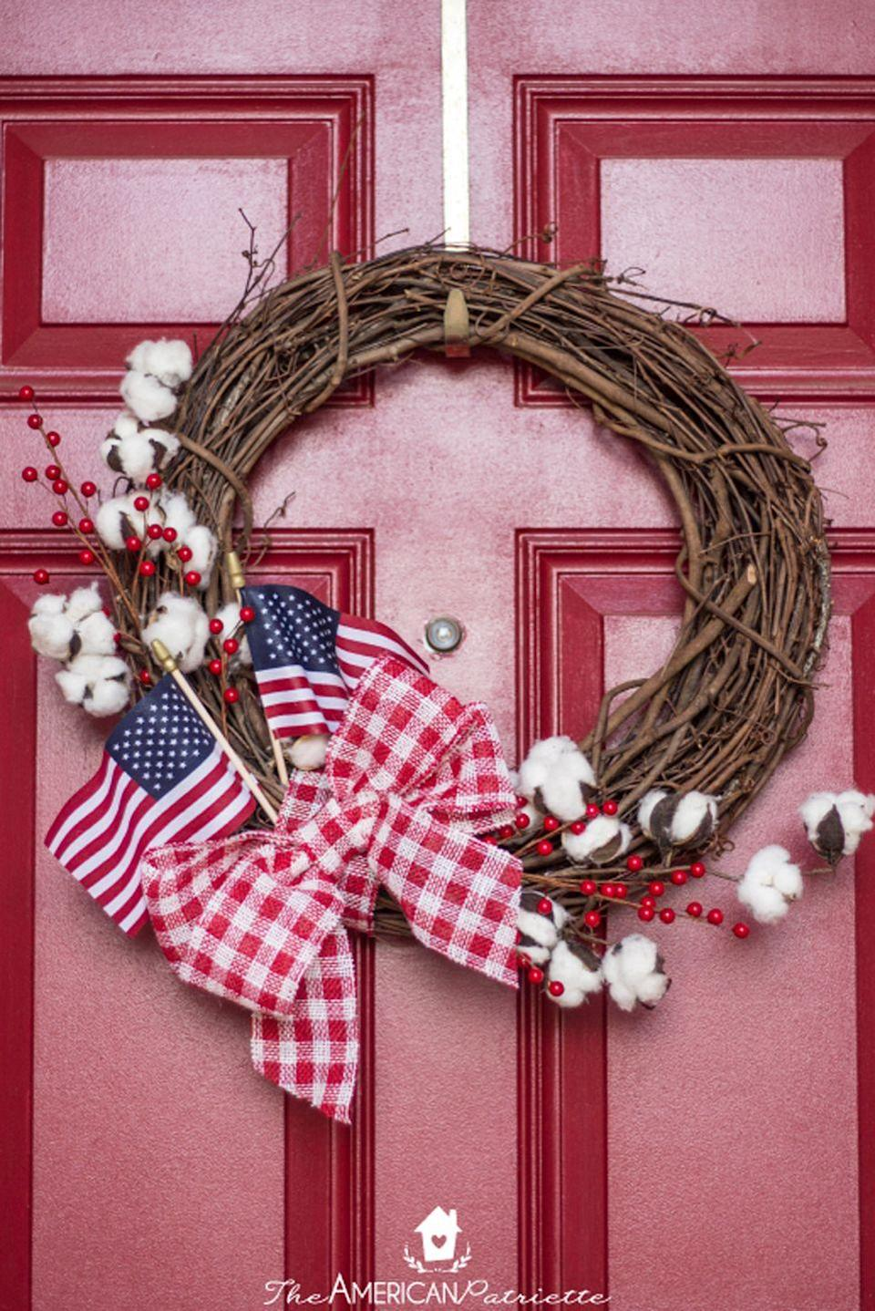 """<p>Add a touch of farmhouse decor to your door with a grapevine wreath adorned with cotton stems, American flags, and a red gingham bow.<br></p><p><strong>Get the tutorial at <a href=""""https://www.theamericanpatriette.com/farmhouse-american-flag-wreath/"""" rel=""""nofollow noopener"""" target=""""_blank"""" data-ylk=""""slk:The American Patriette"""" class=""""link rapid-noclick-resp"""">The American Patriette</a>.</strong><br></p><p><a class=""""link rapid-noclick-resp"""" href=""""https://www.amazon.com/Reliant-Ribbon-93228W-036-40F-Celine-Plaid/dp/B0845KW16T/ref=sr_1_4?tag=syn-yahoo-20&ascsubtag=%5Bartid%7C10050.g.4464%5Bsrc%7Cyahoo-us"""" rel=""""nofollow noopener"""" target=""""_blank"""" data-ylk=""""slk:SHOP RED GINGHAM RIBBON"""">SHOP RED GINGHAM RIBBON</a></p>"""
