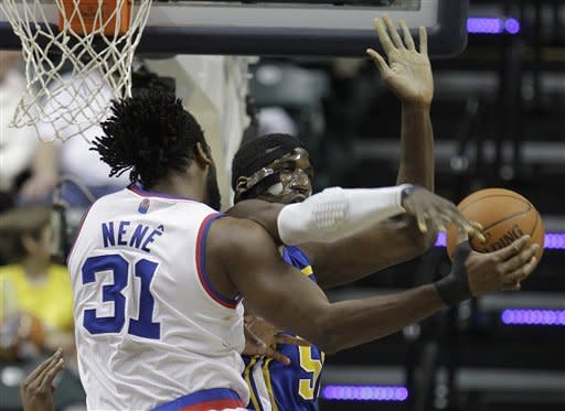 Denver Nuggets' Nene. left, is defended by Indiana Pacers' Roy Hibbert during the second half of an NBA basketball game on Saturday, Feb. 11, 2012, in Indianapolis. Denver won 113-109. (AP Photo/Darron Cummings)