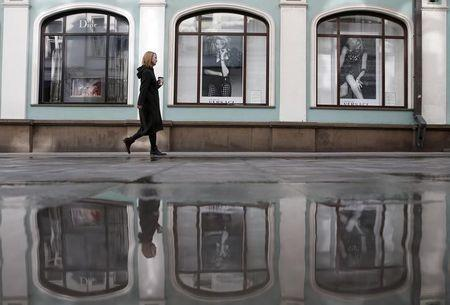 A woman walks along Stoleshnikov Lane, one of the city most expensive shopping areas accommodating numerous boutiques and luxury shops, in central Moscow, March 20, 2015. REUTERS/Maxim Zmeyev/Files