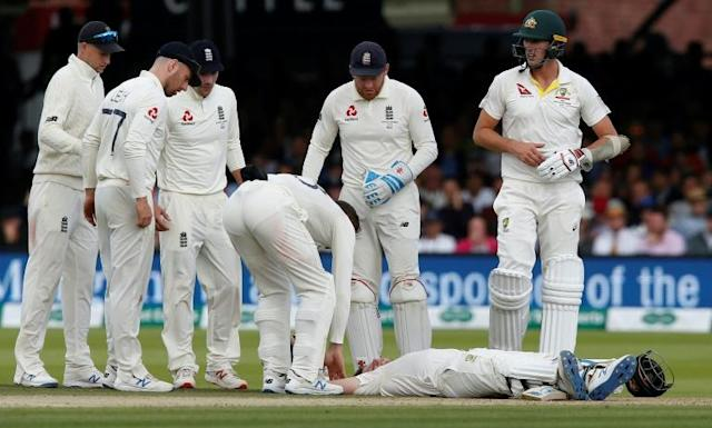 Steve Smith on the pitch after being hit on the head by a ball off the bowling of England's Jofra Archer (AFP Photo/Ian KINGTON)