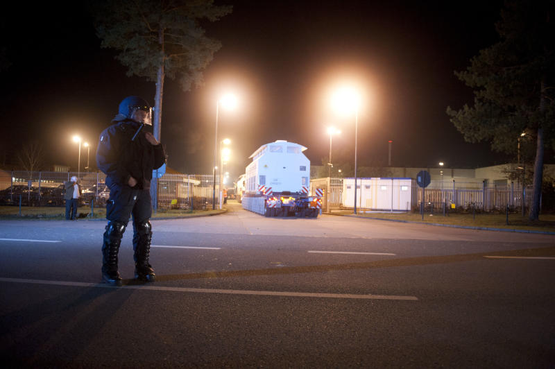 Containers with nuclear waste from France arrive at the interim storage plant in Gorleben, northern Germany, late Monday, Nov. 28, 2011. It was the longest lasting  transport of nuclear waste from La Hague to Gorleben ever.(AP Photo/dapd, Nigel Treblin)