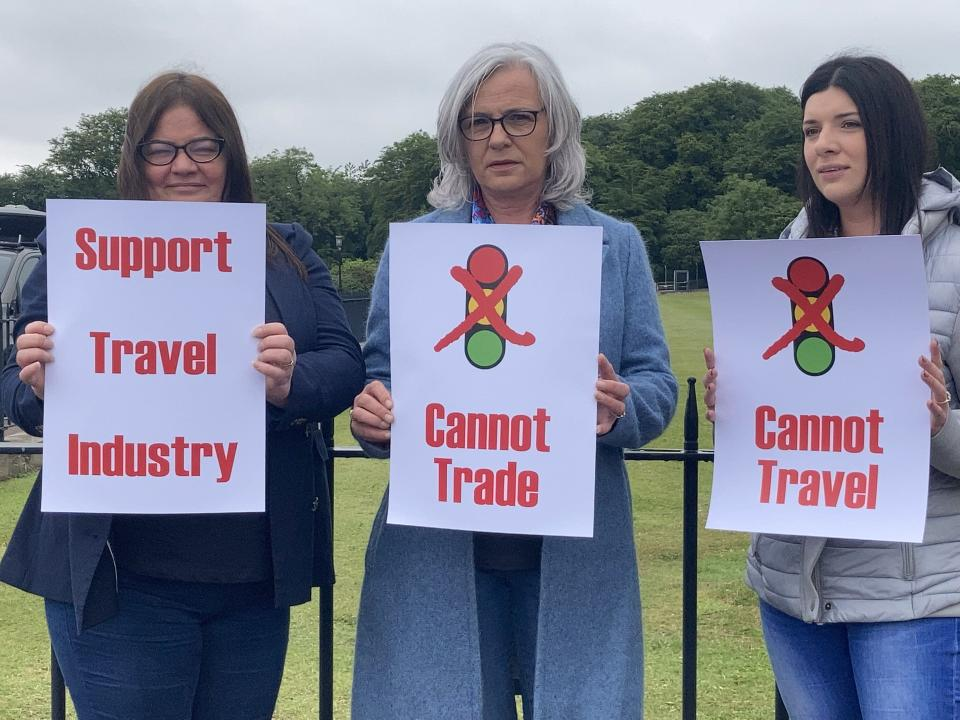 Travel agents take part in a day of action at Parliament Buildings at Stormont in Belfast