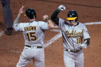 Oakland Athletics' Sean Murphy (12) is congratulated by Seth Brown on his two-run home run off Minnesota Twins pitcher Matt Shoemaker during the fifth inning of a baseball game, Friday, May 14, 2021, in Minneapolis. (AP Photo/Jim Mone)