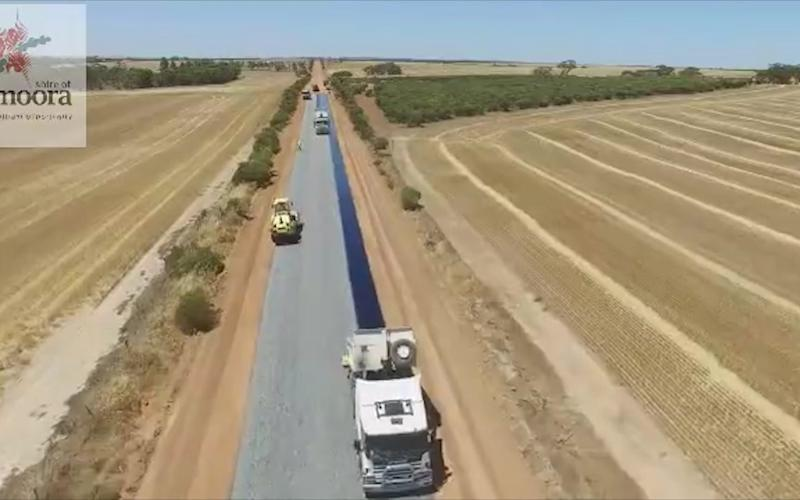 The drone flies over the convoy of road workers