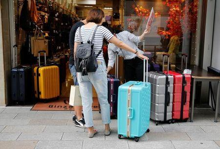 Chinese tourists select rolling bags at Tokyo's Ginza shopping district