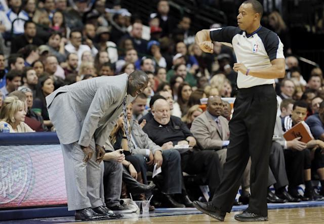 Utah Jazz head coach Tyrone Corbin, left, reacts to a call against his team by referee Rodney Mott during the second half of an NBA basketball game against the Dallas Mavericks on Friday, Nov. 22, 2013, in Dallas. Dallas won 103-93. (AP Photo/Brandon Wade)