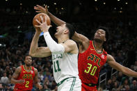 Boston Celtics center Enes Kanter (11) drives to the basket ahead of Atlanta Hawks center Damian Jones (30) during the first half of an NBA basketball game Friday, Feb. 7, 2020, in Boston. (AP Photo/Mary Schwalm)